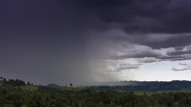 Timelapse rain approaching across countryside - HD, NTSC, PAL video