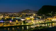 4K Time-lapse: Salzburg Cityscape along the river salzach Austria at dusk video