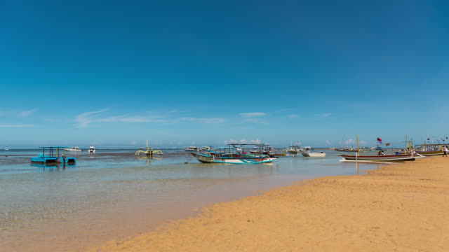 Timelapse : Sanur beach Bali Indonesia have many boat anchored off  in Sanur. Bali. Indonesia video