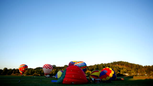 Timelapse shot of hot air balloons taking off video