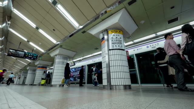Timelapse shot of people on underground station in Seoul, South Korea video