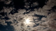 A timelapse shot of the full moon on a cloudy night video