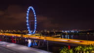 4K Timelapse : Singapore flyer cityscape at night video