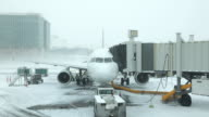 Time-lapse Snowy Airport Gate & Jetliner video