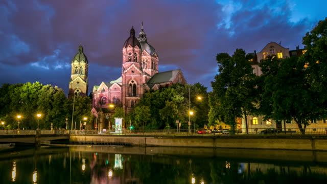 4K Time-lapse: St. Lukas pink church Munich at dusk video