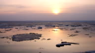 Time-lapse Sunset. Ice drift on the river. In the spring the ice floats video