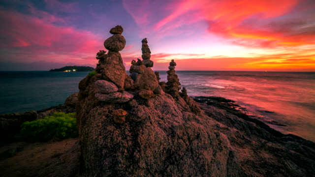 4K TimeLapse. Sunset on the background tourist pyramid of stones on cape at the Phuket Island, Thailand. January, 2016. video