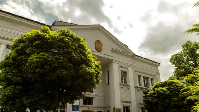 Timelapse. The clouds are moving slowly behind the state building of wedding registration in city Lviv, Ukraine. video