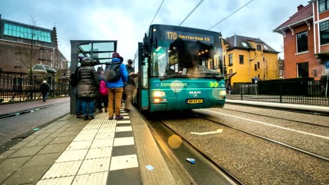 HD Time-lapse Tilt: City Pedestrian and Traffic Amsterdam Museum Garden video
