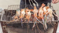 4K Time-lapse tilt up : Chef made shrimp barbecue on hot coal. video