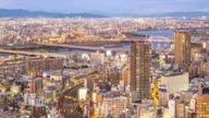 4K Time-lapse: Time-lapse: Osaka Cityscape in action at dusk video