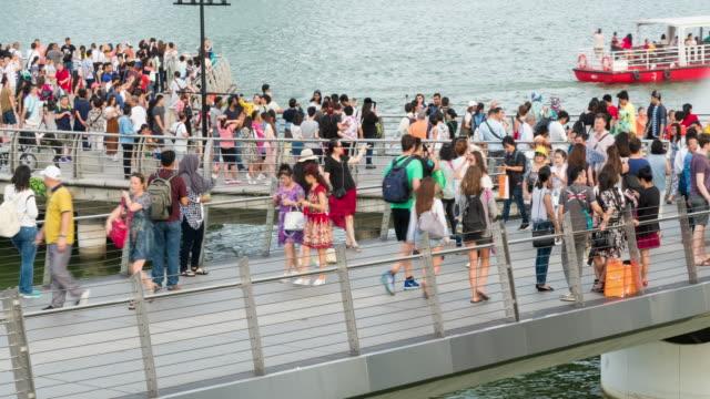 4K Timelapse: Tourist on bridge in Singapore. video