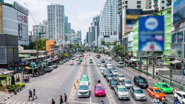 Timelapse traffic and people walking on busy, Crowded street in Asoke junction, Bangkok, Thailand video