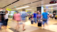 HD Time-lapse: Traveler at Airport Arrival hall Terminal video