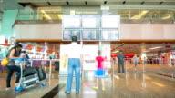 HD Time-lapse: Traveler at Airport Departure Terminal video