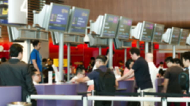 HD Time-lapse: Traveler Crowd at Airport Check In Counter Hall video
