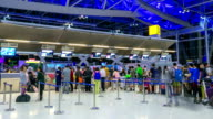 HD Timelapse: Traveler Crowd at Airport Check In Counter Hall video