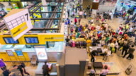 4K Time-Lapse: Traveler Crowd at Airport Check-in Counter Hall video