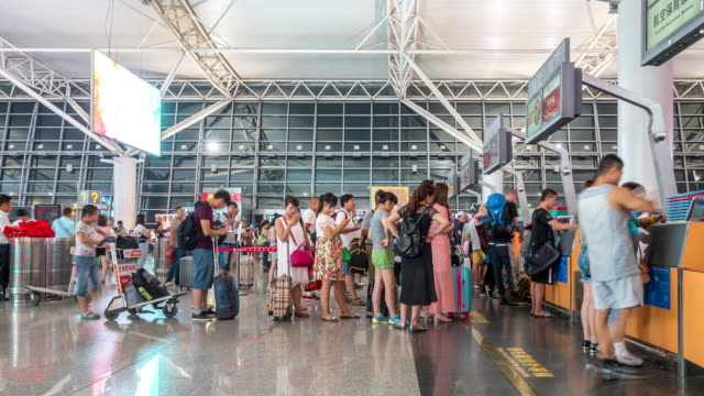Time-lapse: Traveler Crowd at Airport Check-In Counter Hall Xian China video