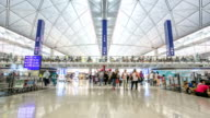 HD Time-lapse: Traveler Crowd at Airport Departure Hall Hong Kong video