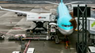 HD Time-lapse: Unloading airplane cargo air freight logistic background video