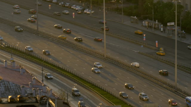Timelapse. Very intense traffic on the streets of the city. In evening time. Wide road. View from the top point. video