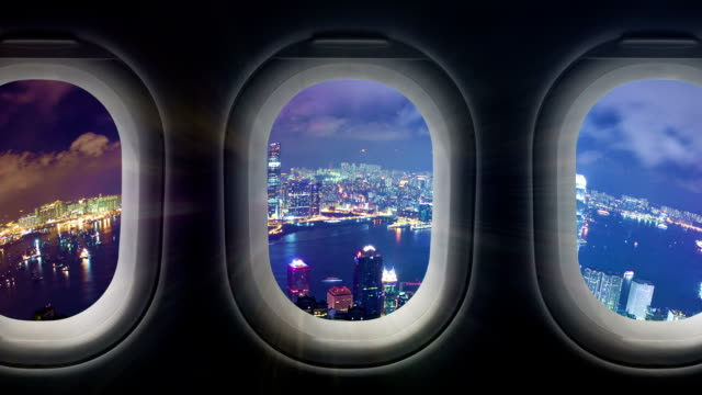 Timelapse video of city at night through airplane window video