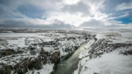 4K time-lapse:  Winter landscape, river and cliff at northern Iceland video