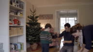 Timelapse Young Family Putting Up Christmas Decorations video