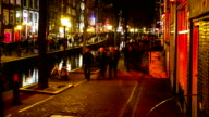 HD Time-lapse Zoom out: Tourist Amsterdam Red Light District night video