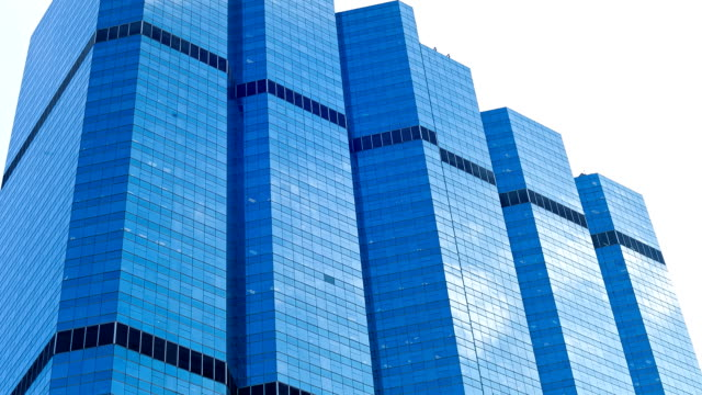 HD Timelapse:Clouds reflecting in mirror of building during the day.(zoom out) video