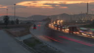 4K Time-lapse:Highway traffic and Oil refinery at twilight Zoom out video