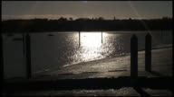 (HD1080) Tiny Canoe Silhoueted On Sparkling Water video