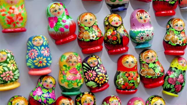 Tiny matryoshka dolls on display in a store video