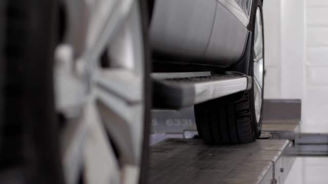 tire balancing, wheel alignment, professional car maintenance video