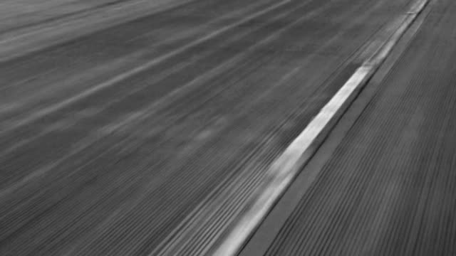 Tire marks on highyway in black and white video