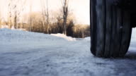 Tire slipping on ice extreme low angle video