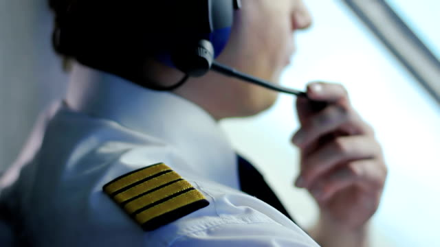 Tired air crew commander navigating airliner, responsible job, commitment video