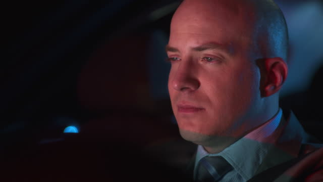 HD DOLLY: Tired Businessman Driving At Night video