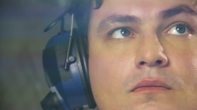 Tired captain of airliner transmitting information to dispatcher by radio video