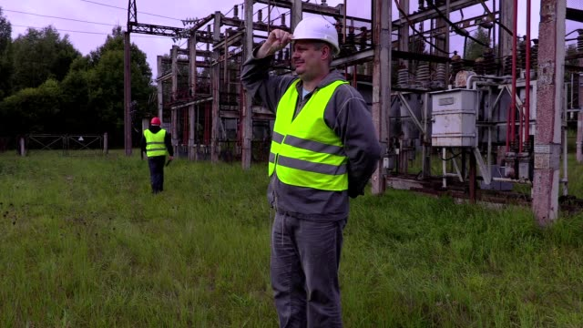 Tired electrician put helmet on head and walking away video