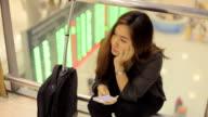 Tired female traveler waiting for departure video