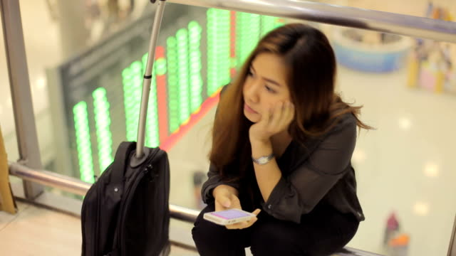 Tired female traveler waiting for departure video