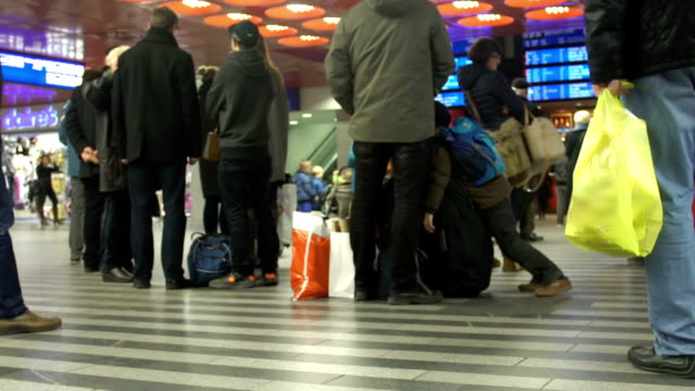 Tired people expecting their flight at the airport, traveling, slow-motion video