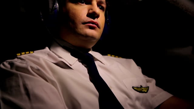 Tired pilot controlling airplane and thinking about home, stressful job video