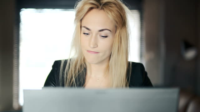 Tired Young Businesswoman Using Laptop In Office video