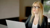 Tired Young Businesswoman Working on Laptop In Office video