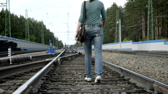 Tired young woman went off by railroad video
