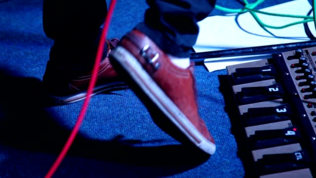 To beat a tattoo, foot against musical electronic equipment video