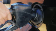 To fill the car with petrol. Open the hatch: open the lid and insert the fuel nozzle video